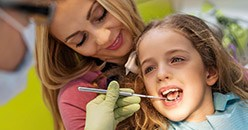 Young girl receiving dental care