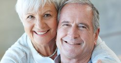 Older couple with healthy smiles