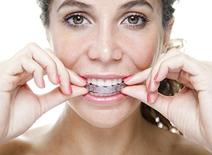 Abington Cosmetic Dentistry Woman placing an Invisalign tray