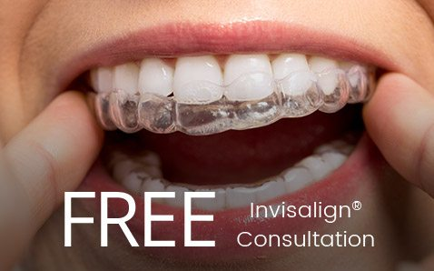 Patient inserting Invisalign tray