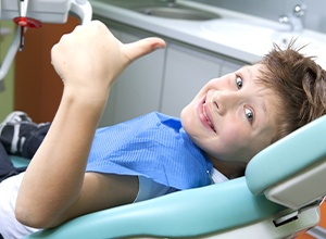 Young boy smiling during dental exam
