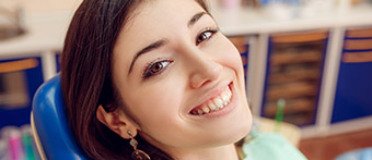 Young brunette woman smiling widely