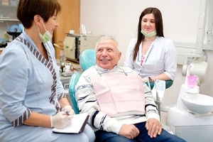 Senior patient smiling because of comfortable tooth extraction