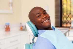 Dental patient smiling prior to tooth extraction in Abington