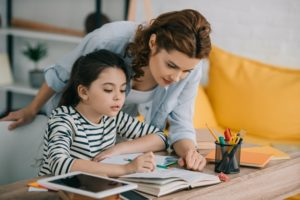 Mother and daughter sticking to a homeschooling schedule